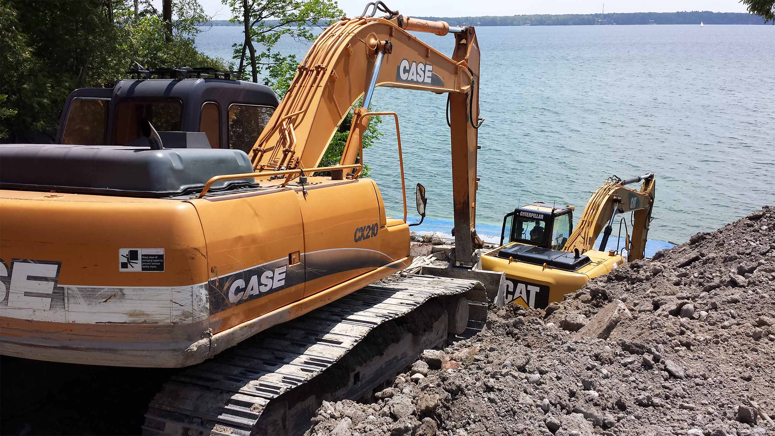 excavators by water